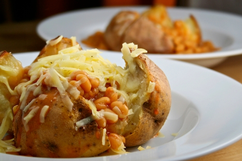 Oven-baked jacket potato with cheese and beans